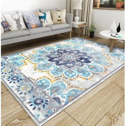 Tapis sol motif traditionnel aspect ancien, couleur avec les différentes nuances de bleu, gris claire et jaune