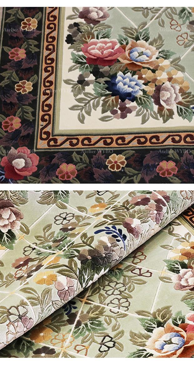 vente tapis haut de gamme pure soie naturelle noué à la main signé Atelier WYBO velours doux sculpté en relief fleurs de printemps sur fond vert pastel effet matelassé